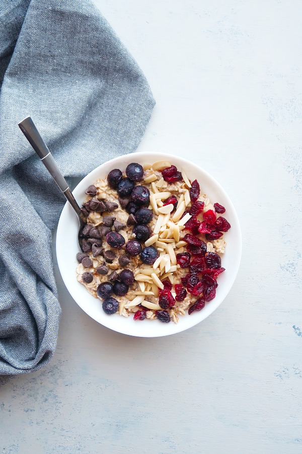 Oats with blueberries and chocolate chips in a bowl.