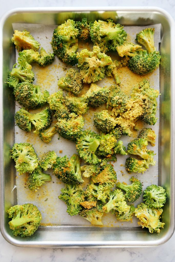 Making roasted broccoli on a pan.