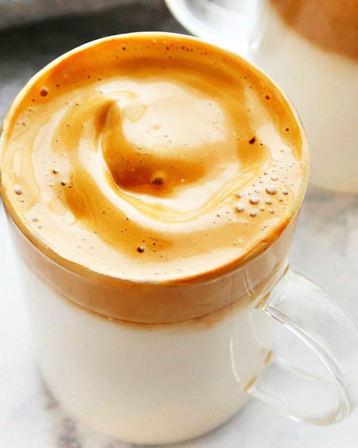 Milk with coffee foam in a mug.