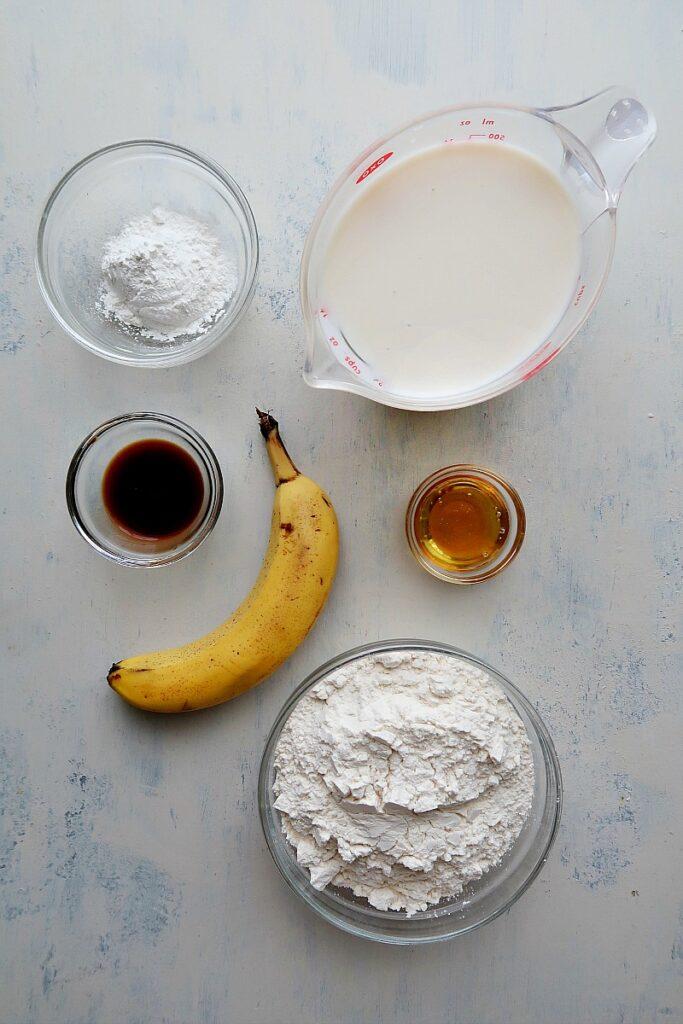 Ingredients for vegan banana pancakes on a board.