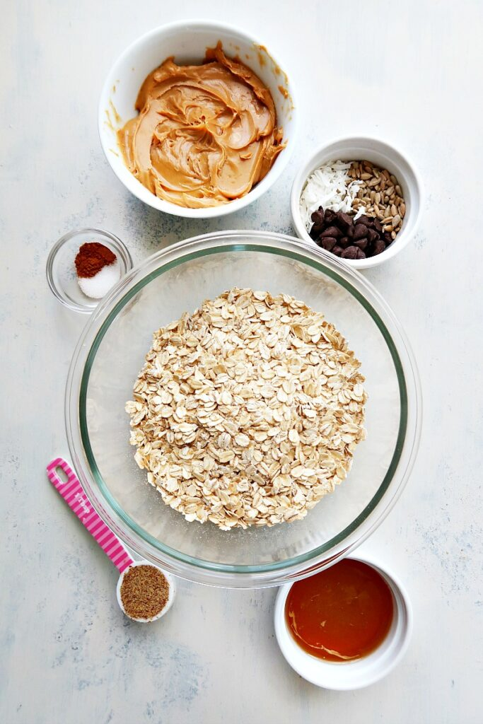 Ingredients for vegan granola bars on a board.
