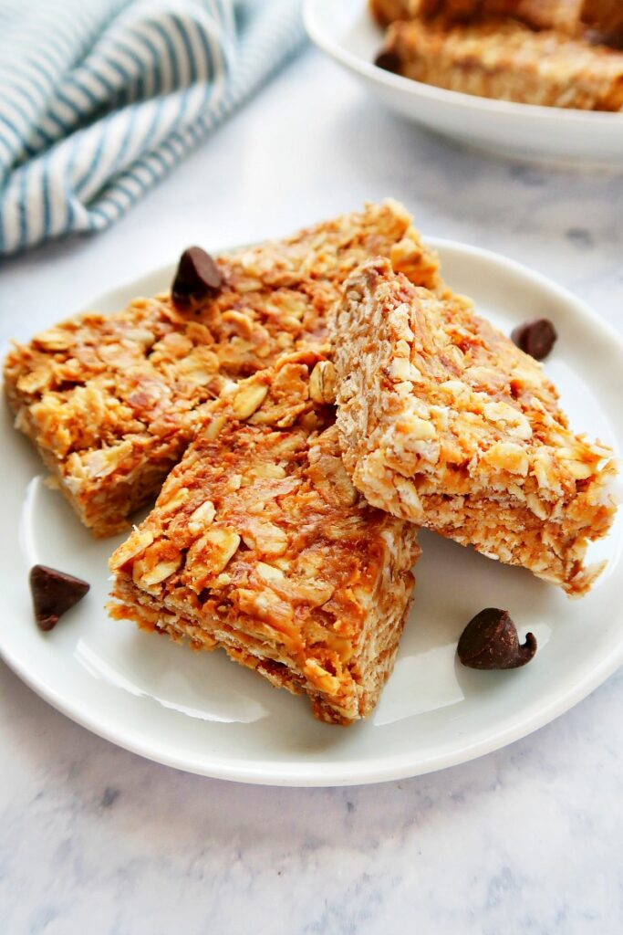 Granola bars with chocolate chips on a plate.