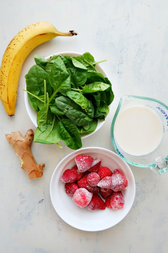Ingredients for vegan breakfast smoothie on a board.