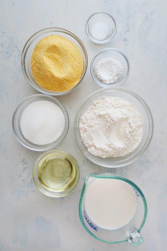 Ingredients for vegan cornbread on a board.