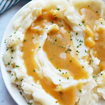 Vegan mashed potatoes with gravy in a bowl.