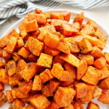 Roasted sweet potatoes on a plate.