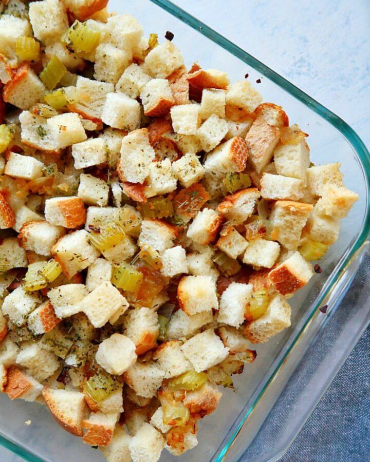 Stuffing in a baking dish on a board.
