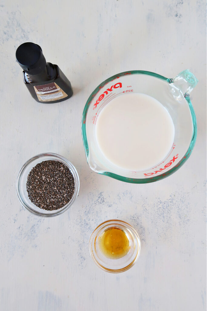 Ingredients for chia pudding on a board.